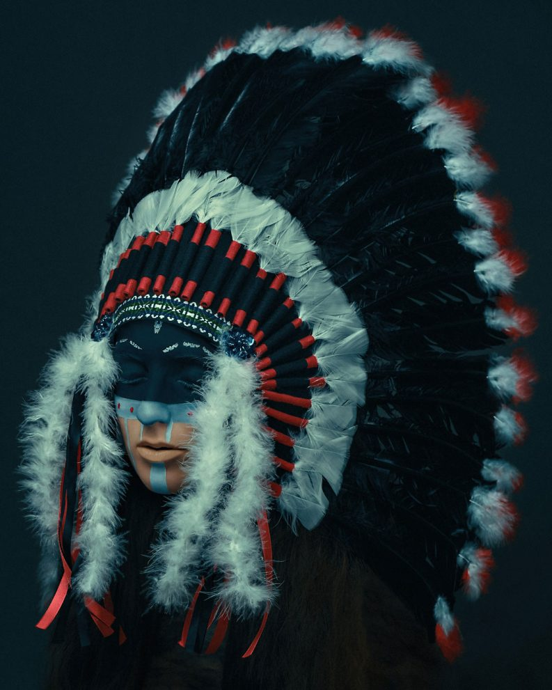 indian native fashion portrait movie faded color grading indiano piume feather headdress